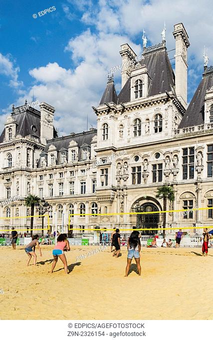people playing volleyball on an artificial urban beach in front of paris city hall part of the so-called -paris plages- project held every year in august, paris