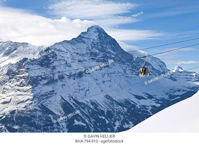 Ski gondola lift in front of the North face of the Eiger mountain, Grindelwald, Jungfrau region, Bernese Oberland, Swiss Alps, Switzerland, Europe