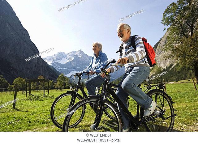 Austria, Karwendel, Senior couple biking