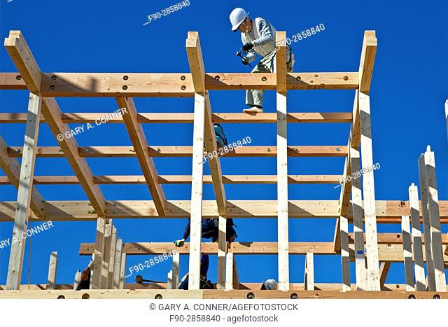 Carpenters work on prefabricated house construction in Ontakesan, Tokyo, Japan