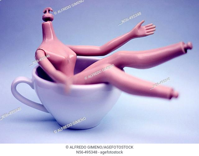 Barbie doll in coffee cup