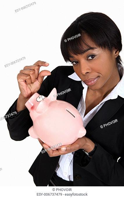 black businesswoman with piggybank