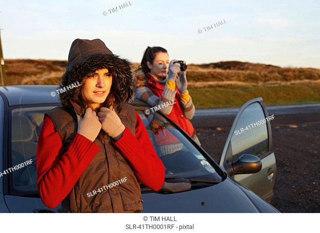 Women admiring landscape from roadside