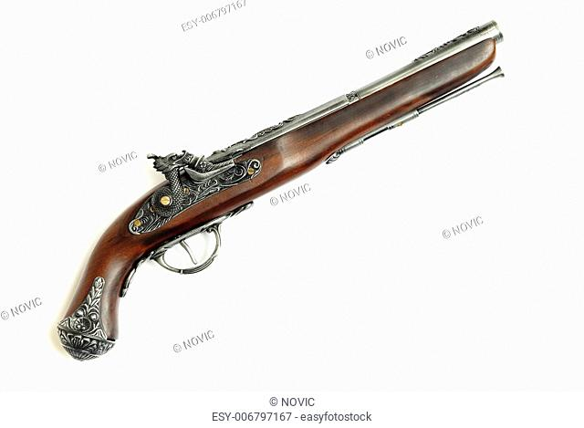 Close-up photo of the ancient pirate pistol on a white background