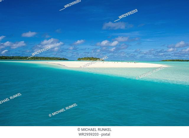 White sand beach and palm fringed beach in Aitutaki lagoon, Rarotonga and the Cook Islands, South Pacific, Pacific