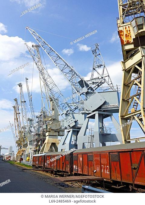 "Historic harbor cranes at """"Schuppen 50"""", Hansahafen, Harbor museum Hamburg, Germany"
