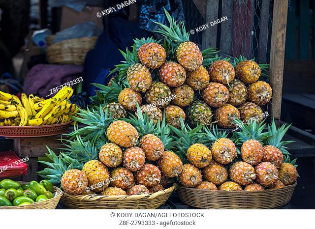 Pile of pineapples in a fruit market in Antigua Guatemala