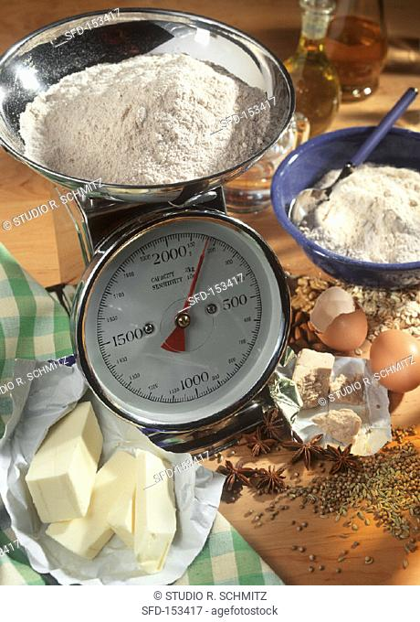 Still life with kitchen scales & various baking ingredients