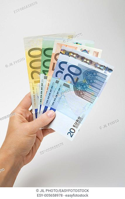 woman hand with Euros