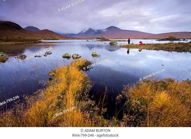 Photographers capturing the autumn colours beside Lochan Nah Achlaise on Rannoch Moor, Highlands, Scotland, United Kingdom, Europe