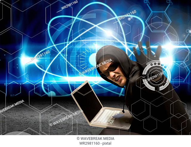 Hacker with sunglasses using a laptop and tending his arm to the lens with a digital background