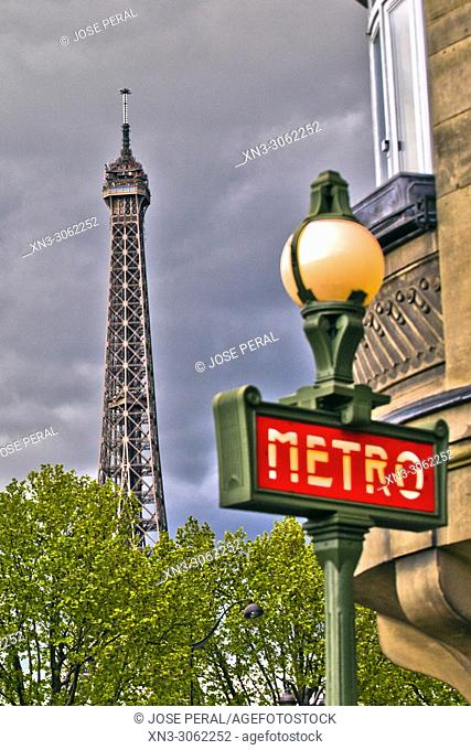 On background Eiffel Tower, Tour Eiffel, Subway station entrance lamp, metro station sign, Metropolitain, Paris, France, Europe