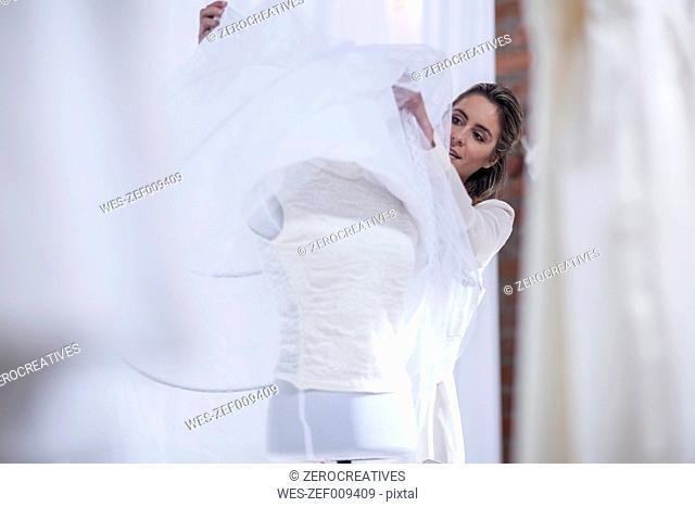 Dressmaker with wedding dress