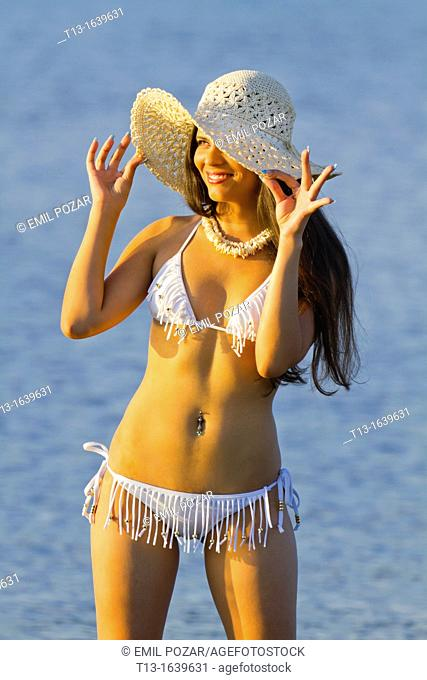 Smiling young woman in White bikini