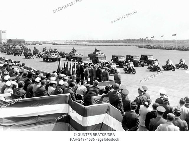 Soldiers of the US Army driving past the VIP stand at airport Tempelhof in Berlin on occasion of a parade for the 'Armed Forces Day' on 16th May 1953