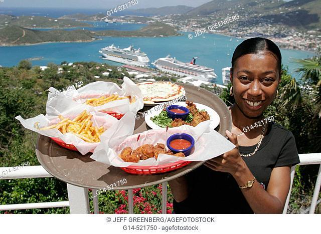 Black female waitress, food, Charlotte Amalie Harbor, Caribbean Sea, cruise ships. Paradise Point. St. Thomas. US Virgin Islands