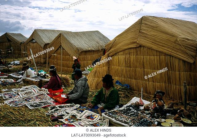 The floating islands of Lake Titicaca are inhabited by the Uros people,who make a living by selling goods and souvenirs to tourists