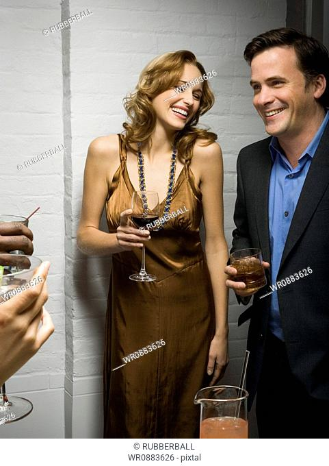 Man and a woman enjoying a party