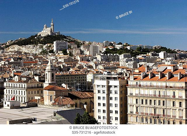 French. Provence. Marseille. The cityscape of Marseille with Basilica of Notra Dame de la Garde in the background