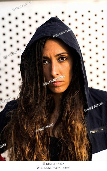 Portrait of young woman wearing a hoodie