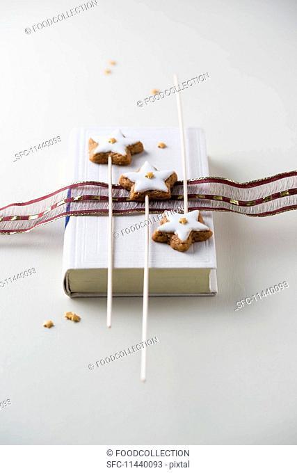 Cinnamon stars decorated with mini sugar stars on sticks