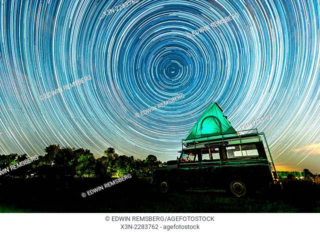 Land Rover at night with moving stars in the sky in Fallston, Maryland, USA