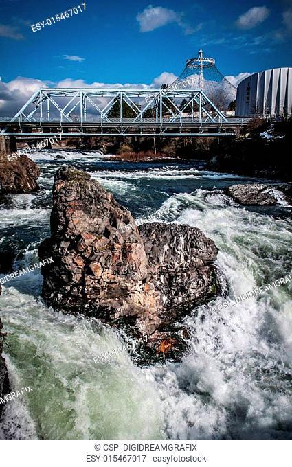 rushing white waters around rock