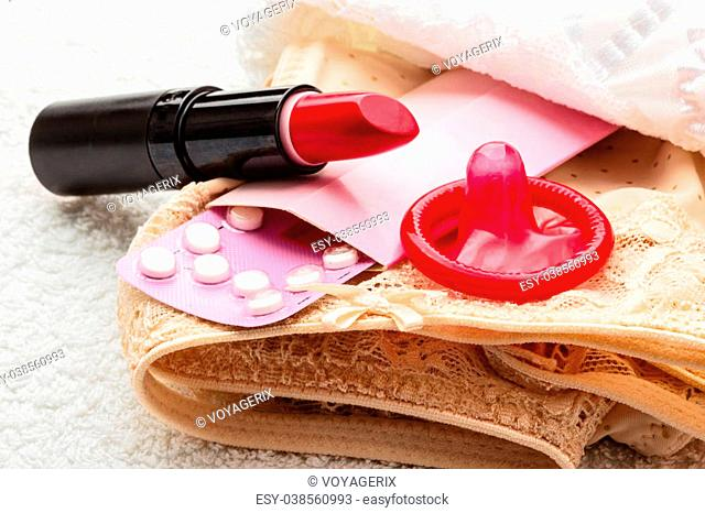 Condom and red lipstick Stock Photos and Images | age fotostock
