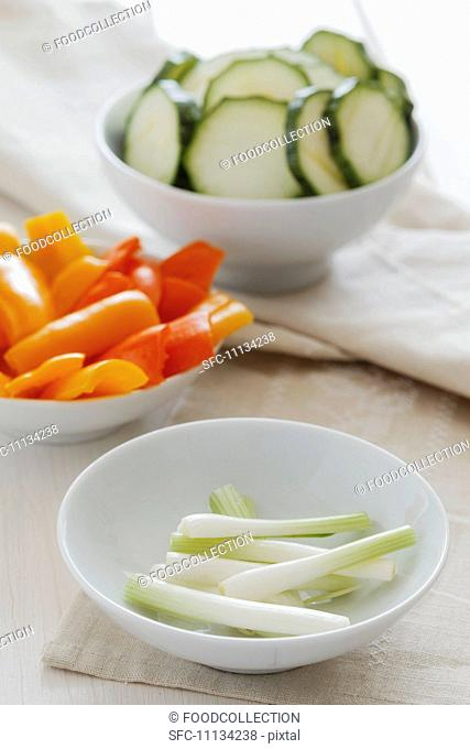Pepper, courgette and spring onions cut into bite-sized pieces for vegetable tempura