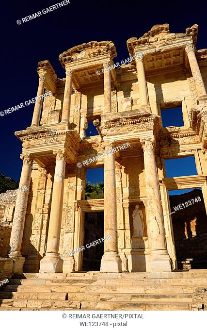 Morning sun on the facade of the Roman Library of Celsus with statue of Arete in ancient Ephesus Turkey