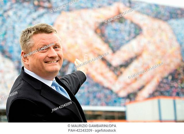 Secretary-general of the CDU, Hermann Groehe, presents a huge banner of his party at Washington Square in Berlin, Germany, 02 September 2013