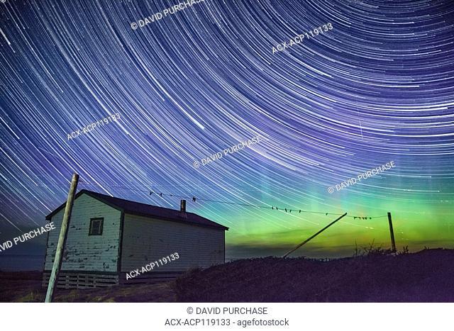 Star Trails & Northern Lights Aurora Borealis over Broom Point, Gros Morne National Park, Newfoundland and Labrador
