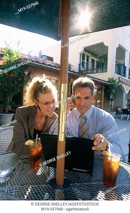 Businessmen at outdoor café