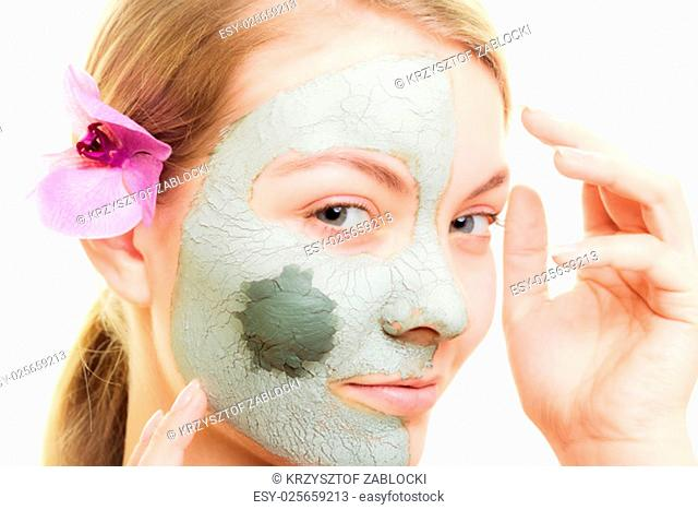 skin care. woman in clay mud mask on face isolated on white. girl taking care of dry complexion. beauty treatment