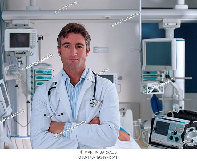 Doctor standing in hospital intensive care with arm closed