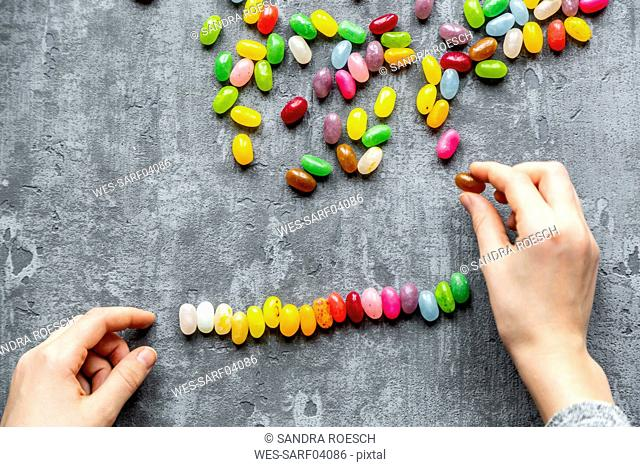 Row of colourful sweet jellybeans on gray background
