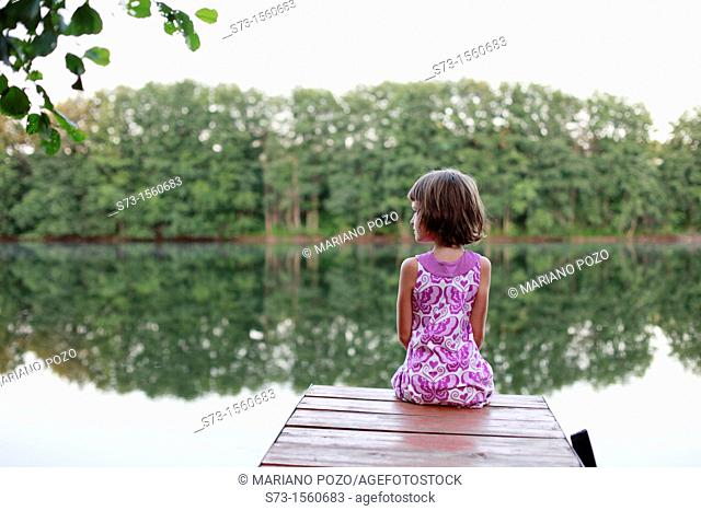 Girl on the pier in Lake Avral, Kirillovka, Samara Region, Russian Federation