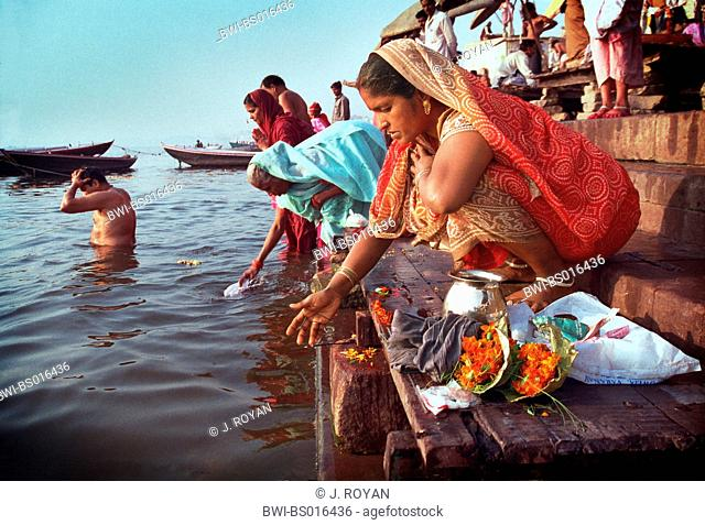 women washing in Ganges, India