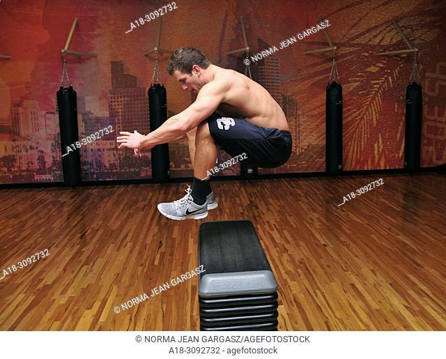 Workout in a gym with hurdles, Marana, Arizona, USA