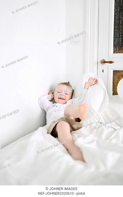 Happy boy on bed