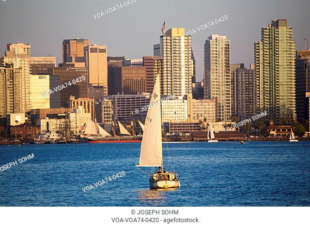 Scenic San Diego skyline, sailboat and waterfront, Pacific Ocean at sunset, California