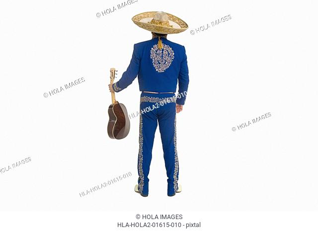 Portrait of Mariachi playing guitar and singing