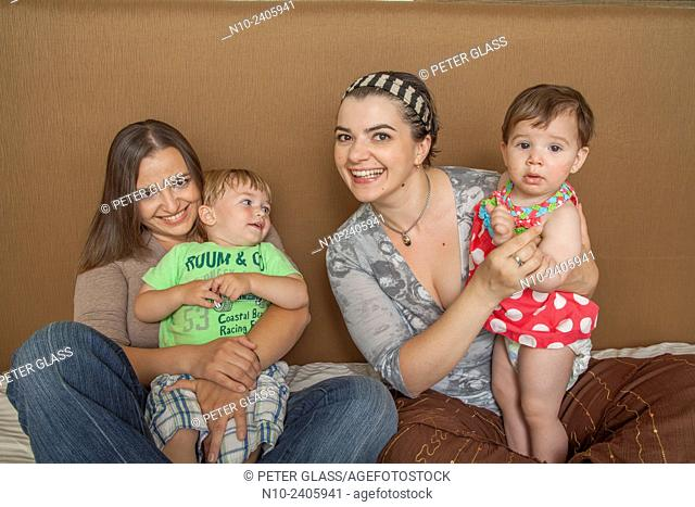 Sisters with their young son and daughter