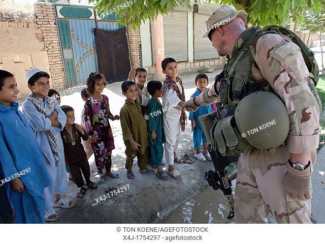 Dutch police mentors walking patrol with Afghan police officers in Kunduz