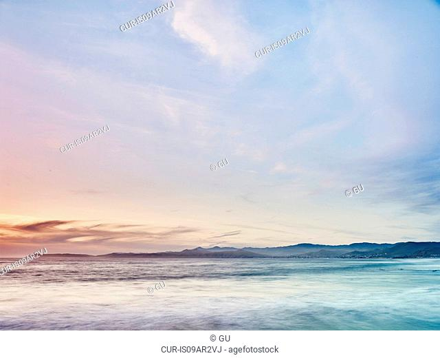 View of blurred ocean waves, Morro Bay, California, USA