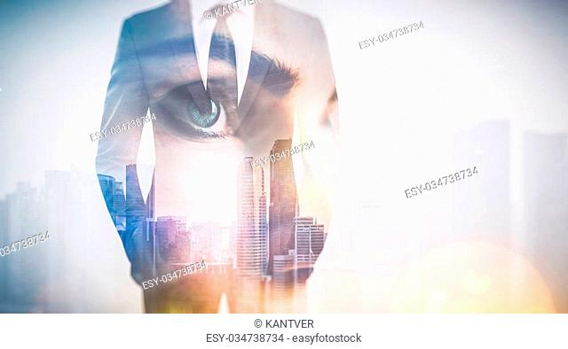 Photo of woman eye and businessman in suit. Double exposure skyscraper on the background. Horizontal