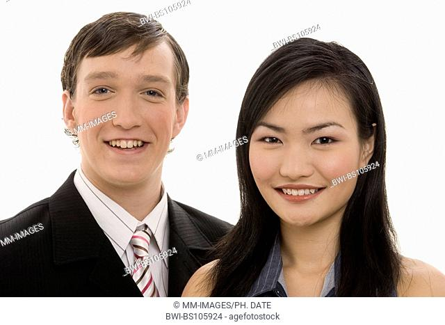 A smiling pair of business people