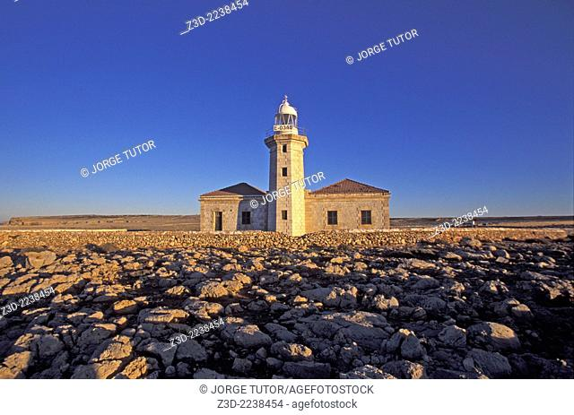Punta Nati lighthouse at sunset. Menorca
