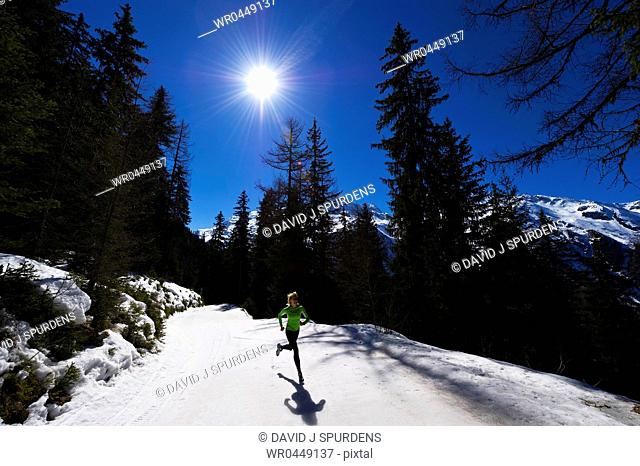 A jogger running on snowy mountains