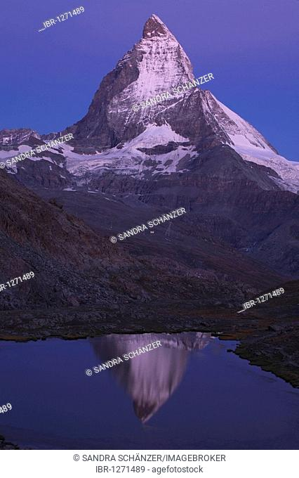 Reflection of the Matterhorn mountain in the Riffelsee lake, Valais, Switzerland, Europe